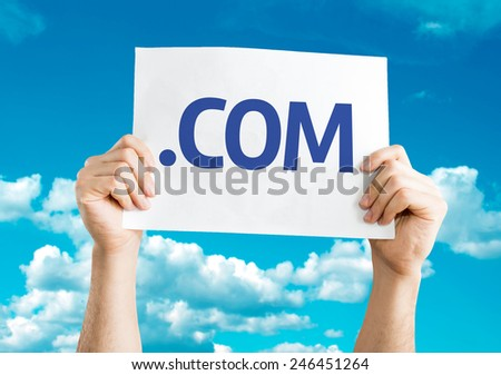 .COM card with sky background - stock photo