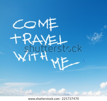 """come travel with me"" written in the sky with contrails left by airplane - stock photo"