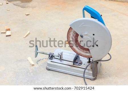 Compound mitre saw with circular blade for cutting metal and plastic