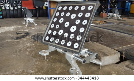 computerized alignment car tire machine clamp - stock photo