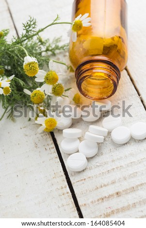 Concept of homeopathy. Pills and natural herbs. Selective focus. - stock photo