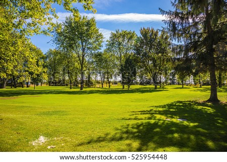 Concept of  tourism. French Canada. Golf Course surrounded by beautiful autumn park