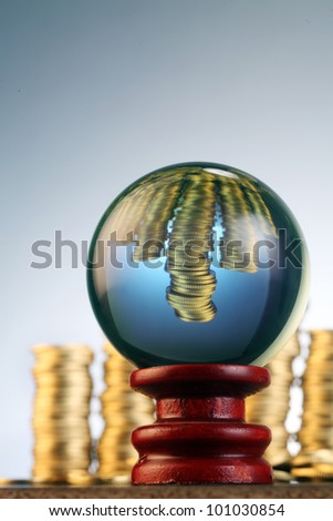 conceptual image  coin in the crystal ball - stock photo
