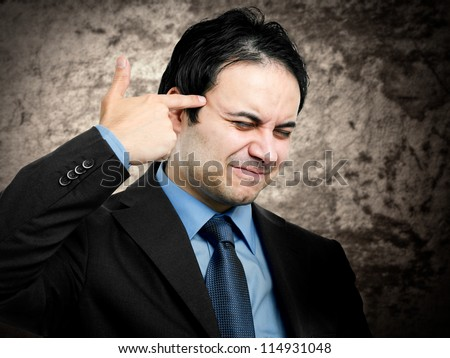 Conceptual image of a businessman shooting himself for business problems