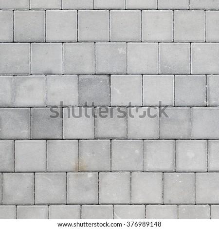 concrete tiled pavement background - stock photo