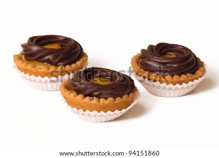 Confectionery chocolate cupcakes and cookies. - stock photo