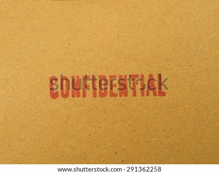 """Confidential"" printed on brown vintage envelope, in macro - stock photo"