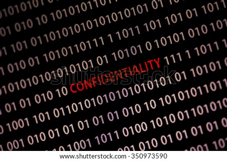 'Confidentiality' word in the middle of the computer screen surrounded by numbers zero and one. Image is taken in a small angle. Image has a vintage effect applied.