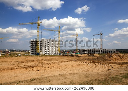 construction of the new house in the new area in the city. Belarus - stock photo