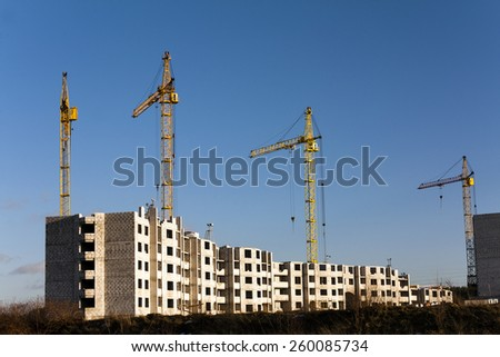 construction site on which construction of a new multystoried house is carried out. - stock photo