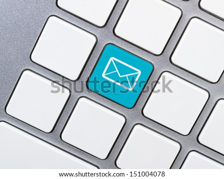 """Contact Us"" concept, balloon icon, blue button or key on white keyboard. - stock photo"