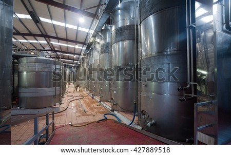 contemporary  winery factory with  stell barrels