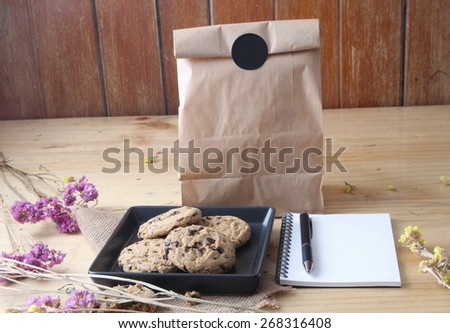 cookie and notebook - stock photo