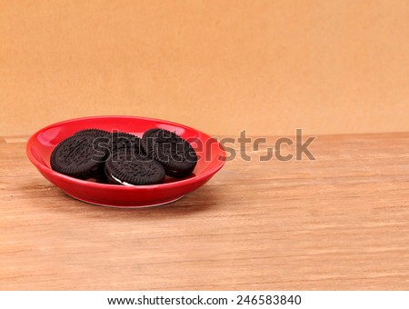 Cookies chocolate in red plate on wooden . - stock photo