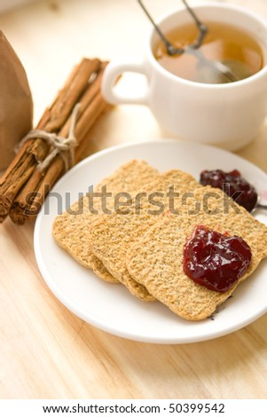 cookies with marmalade cinnamon and cup of tea - stock photo