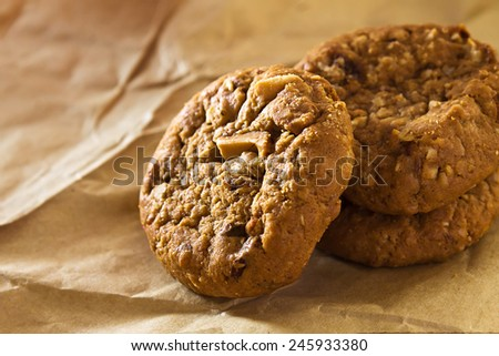 cookies with nuts and raisins on brown paper - stock photo