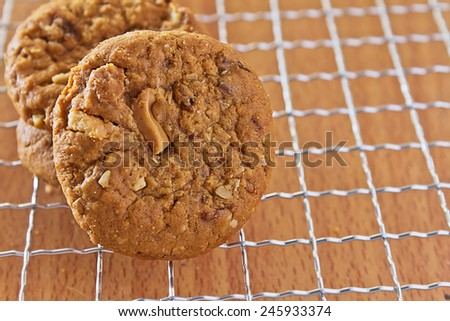 cookies with nuts and raisins on the cooling rack - stock photo