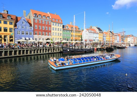 Copenhagen, Denmark - June 30, 2014: Touristic vessel on the Nyhavn Canal, Copenhagen, Denmark - stock photo
