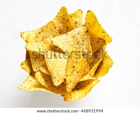 corn nachos on light wooden table. top view