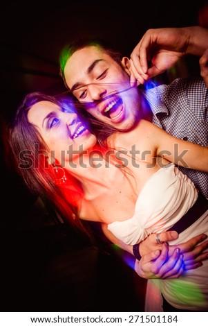 Couple having fun in night club  - stock photo