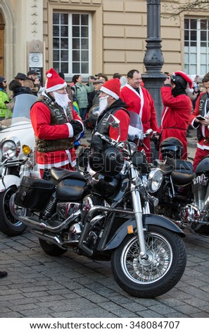 CRACOW, POLAND - DECEMBER 6, 2015: CRACOW, POLAND - DECEMBER 8, 2013: the parade of Santa Clauses on motorcycles around the Main Market Square in Cracow. Poland