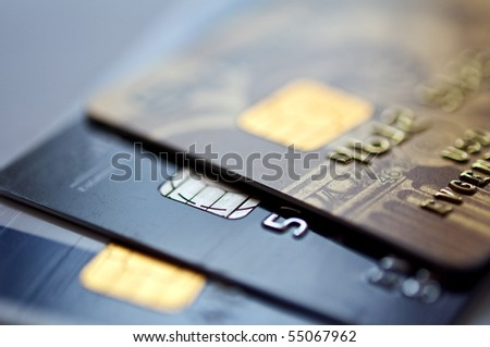 credit cards on a blue background, selective focus. closeup.