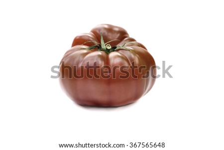 Crimea black tomato isolated on white background