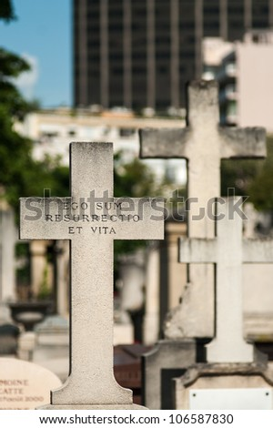 cross with latin inscription 'ego sum resurrectio et vita' (I'm the ressurrection and the life) - stock photo
