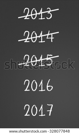 2013, 2014, 2015 crossed and new years 2016, 2017 on chalkboard - stock photo