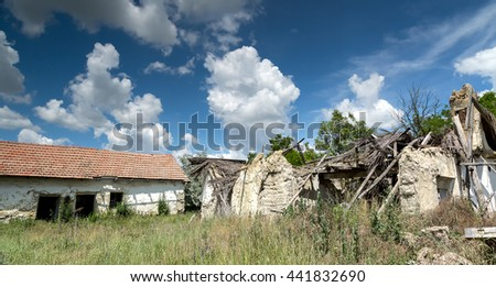 Crumbling farm from Hungary  - stock photo