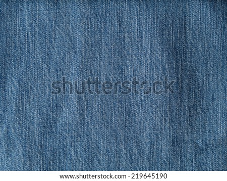 Crumpled denim fabric texture, textile background - stock photo