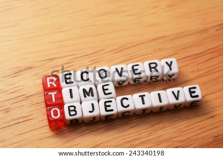 cubes with text , rto recovery time objective on wood