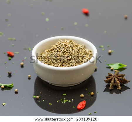 (Cumin seeds) Spices and herbs on tile background, Top view indian spices and herbs difference ware on tile background with copy space for design spices, herbs or foods content.