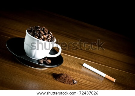 ,cup coffee,beans coff�¨�¨ and cigarette on vintage wood, - stock photo