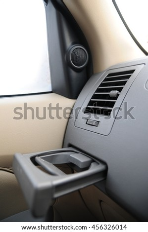 """""""Cup holder"""" Cup holders in cars. Where to place the water glass. - stock photo"""