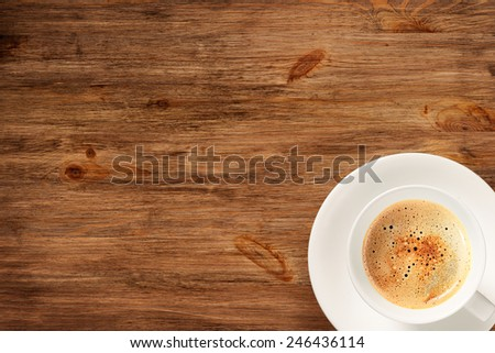Cup of coffee on wooden desk. Top view - stock photo