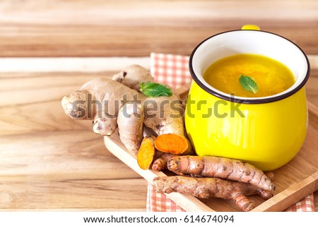 cup of Turmeric Tea with lemon and ginger , Benefits for reduce Inflammation , Liver Detox and Cleanser healthy herb drink concept