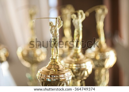 Cups of winners in sport. Victorious cups on golf. Cups of winners on golf. Game golf. - stock photo