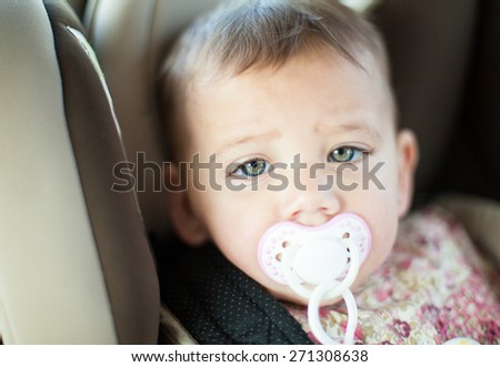cute baby in a car - stock photo