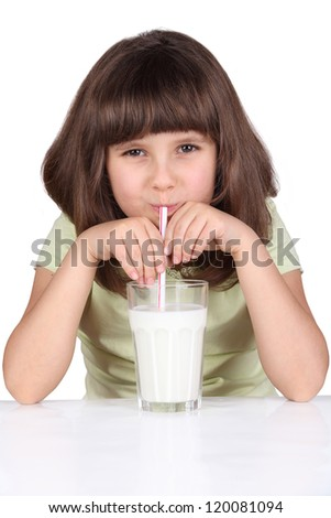 Cute little girl drinks milk using drinking straw, isolated on white - stock photo