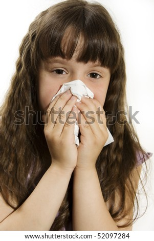 Cute little girl with the flu - isolated over white - stock photo