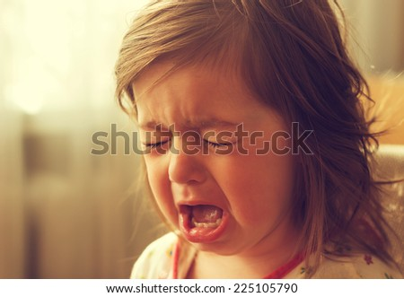 cute little kid is crying - stock photo