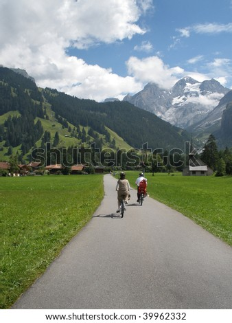 Cycling in the Alps. - stock photo
