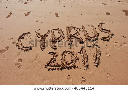 """Cyprus 2017"" written in the sand on the beach"
