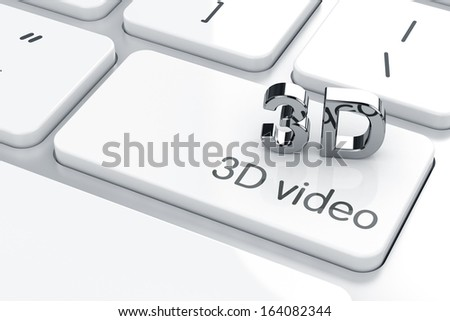 3D chrome icon on the computer keyboard. 3D video concept - stock photo