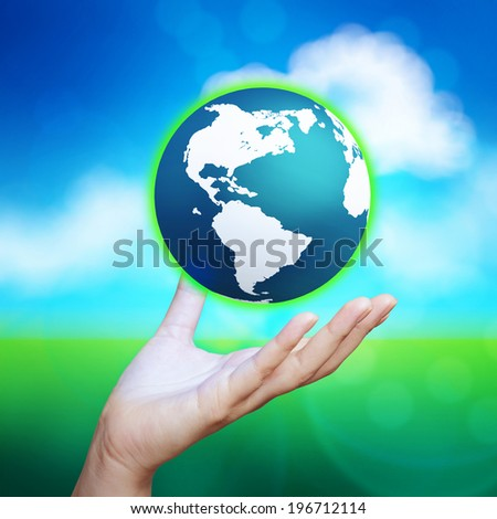 3d earth globe in her hand against blue and green nature background - stock photo