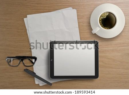3d empty tablet and a cup of coffee on the wooden desk  - stock photo