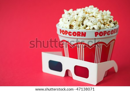 3D glasses & a bucket of popcorn - 3D cinema concept, shallow dof - stock photo