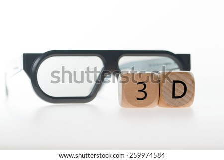 3D glasses and wooden cube with 3D / 3D - stock photo