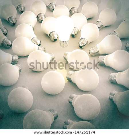3d growing light bulb standing out from the unlit incandescent bulbs as vintage style concept - stock photo